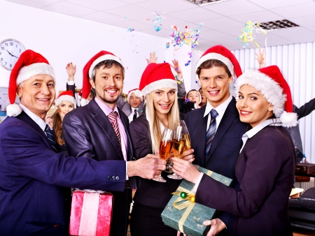 Foto de Happy business group people in santa hat at Xmas party. - Imagen libre de derechos