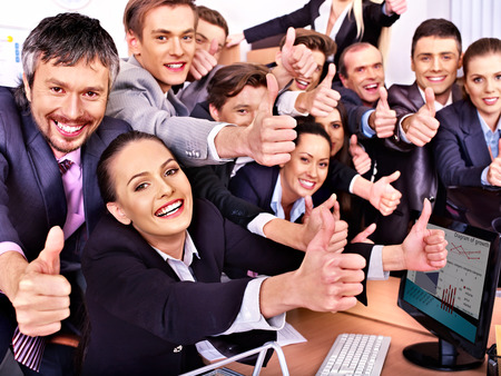 Photo for Happy group business people thumb up  in office. - Royalty Free Image