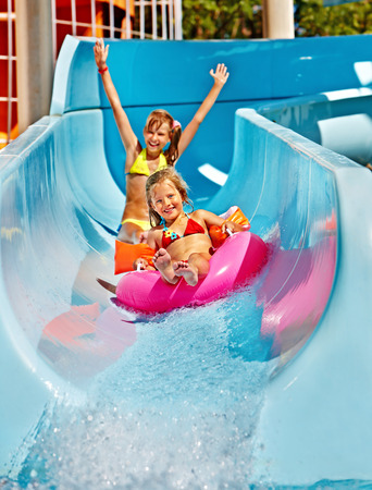 Photo for Children  on water slide at aquapark. Summer holiday. - Royalty Free Image