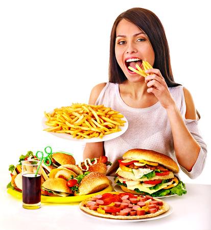 Photo pour Woman eating fast food. Isolated. - image libre de droit