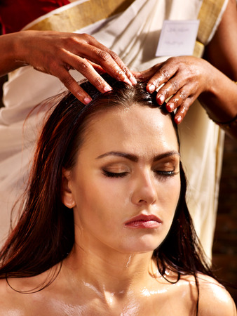 Photo for Young woman having head ayurveda spa treatment. - Royalty Free Image