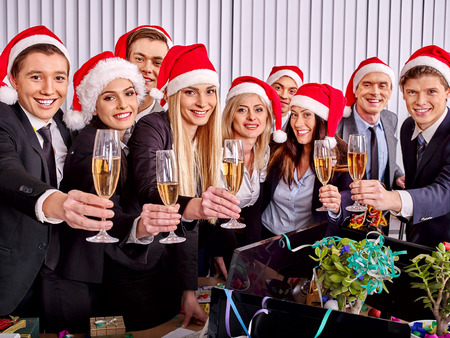 Photo pour Happy business group people in santa hat drinking champagne  Xmas - image libre de droit