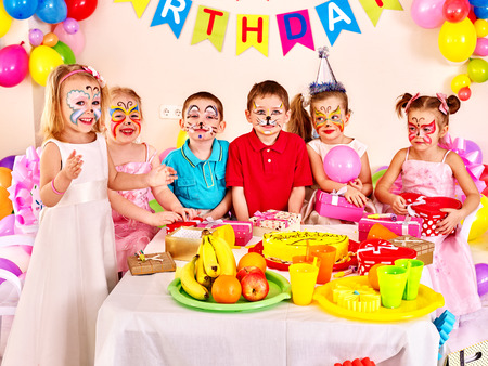Photo for Group of children happy birthday party . Food on table. - Royalty Free Image
