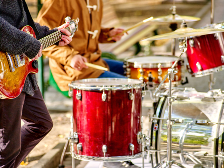 Photo for Hands with bass drum of music street male performers playing percussions on autumn outdoor. - Royalty Free Image