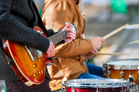 Photo for Music street performers on autumn outdoor. Middle section of body part with guitar. - Royalty Free Image