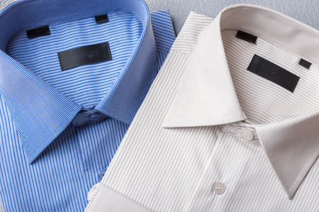 Photo for Studio shot of couple of man's shirts on a grey background - Royalty Free Image