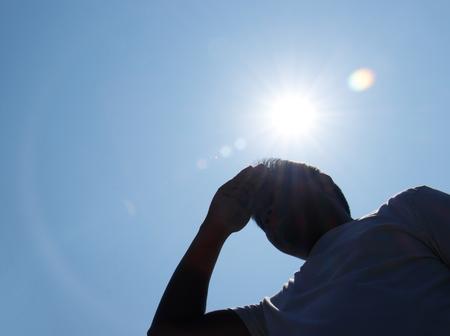 Foto de Young man and heat stroke. - Imagen libre de derechos