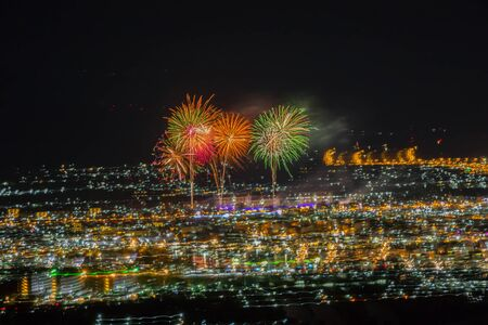 fireworks light over downtown Loei Province, Thailand