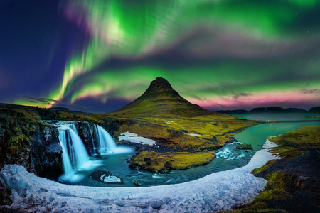 Photo pour Northern Light, Aurora borealis at Kirkjufell in Iceland. Kirkjufell mountains in winter. - image libre de droit