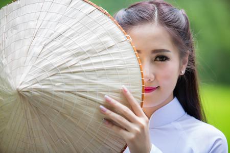 Foto de Portrait of laos girls Vietnam traditional dress, famous traditional costume for woman in VIetnam. - Imagen libre de derechos