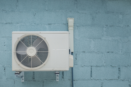 Photo pour Condenser air conditioner with vintage brick background - image libre de droit