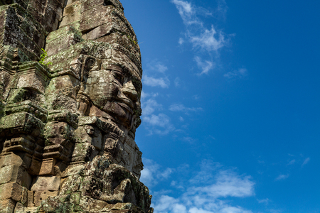 Photo for Stone faces on the towers of ancient Bayon Temple in Angkor Wat, Siem reap in Cambodia. - Royalty Free Image