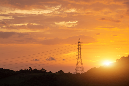 Photo pour Electricity transmission power lines at sunset, High voltage tower. - image libre de droit