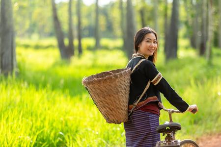 Foto de Happy Hmong women smiling sit outside at Giang Ta Chai village, close to Sapa town, Lao Cai province, northern Vietnam. - Imagen libre de derechos