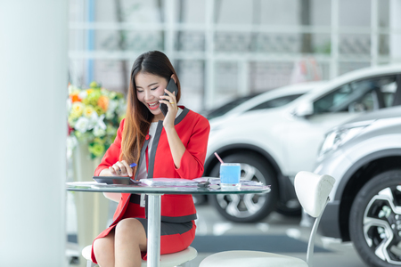 Photo for auto business, car sale, gesture and people concept - smiling businessman talking on smartphone over auto show background - Royalty Free Image