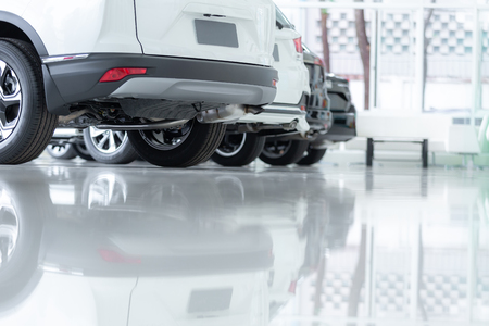 Photo pour Cars For Sale, Automotive Industry, Cars Dealership Parking Lot. Rows of Brand New Vehicles Awaiting New Owners, on the epoxy floor in new car service - image libre de droit