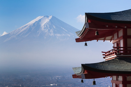 Mt. Fuji viewed from behind red Chureito Pagoda, Japan during late winter