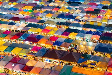 Foto de Multiple roof top walking flea market, cityscape downtown background - Imagen libre de derechos