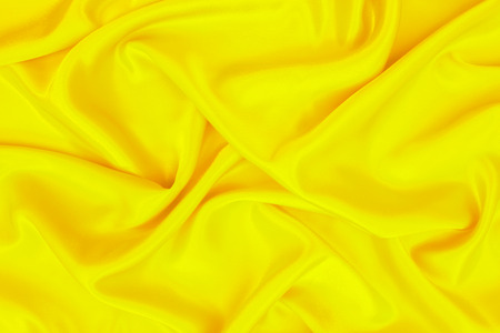 Foto de abstract background yellow luxury cloth or wavy folds of grunge silk texture material - Imagen libre de derechos