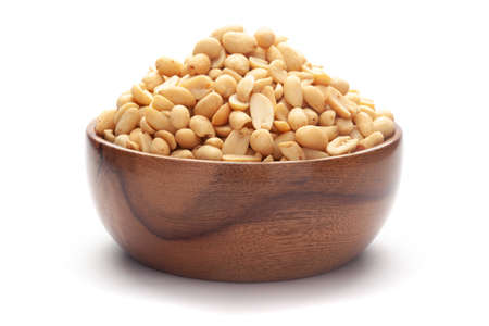 Close up of Salted Peanuts Indian namkeen (snacks) In hand-made (handcrafted) wooden bowl