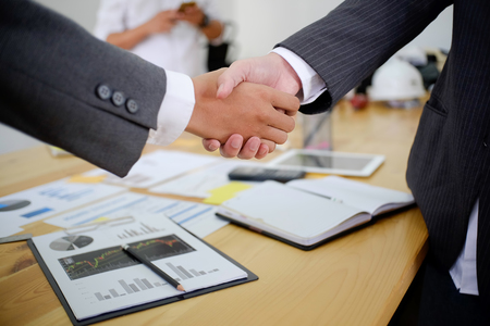 Photo for acquisition business people shaking hands, finishing up a meeting. - Royalty Free Image