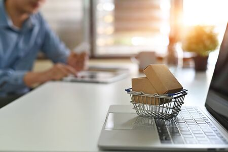 Photo for Shopping online concept, Boxes in a trolley online shopping is a form of electronic commerce . - Royalty Free Image