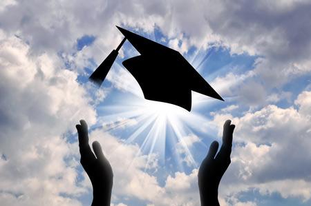 Foto de Hands graduate cap throw up in sky. concept of education - Imagen libre de derechos