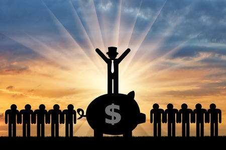 Photo for Concept of economic inequality. Rich man standing on a big piggy Bank with money next to ordinary people - Royalty Free Image