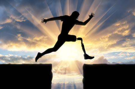 Photo for Concept of disability. Man with the prosthetic leg runs and jumps across the chasm - Royalty Free Image