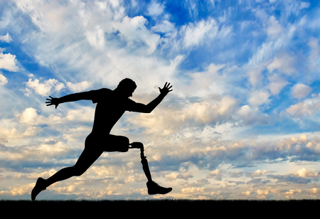 Photo for Running a disabled person with a prosthetic leg, confidently running on the ground - Royalty Free Image