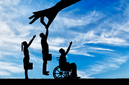 Photo for Employer's hand chooses a healthy worker from a crowd of people and not an invalid in a wheelchair. The Concept of Discrimination and Inequality in the Employment of People with Disabilities - Royalty Free Image