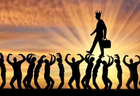 Photo for Silhouette of a walking man with a crown on his head on the hands of the crowd. - Royalty Free Image