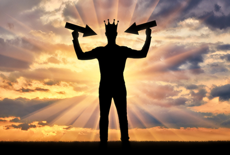 Photo for Silhouette of a man with a crown on his head tries to attract attention by holding pointer in his hands. - Royalty Free Image