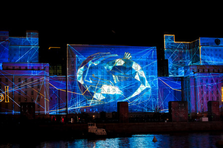 Photo for MOSCOW, RUSSIA - OCTOBER 03, 2015: International Festival Circle of Light. Laser video mapping show on facade of the Ministry of Defense in Moscow, Russia - Royalty Free Image