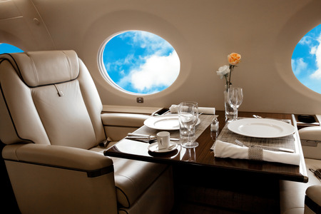 Photo pour Aircraft (jet) porthole with blue sky view, flight by business class - image libre de droit