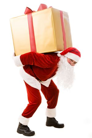 Photo for Photo of happy Santa Claus carrying big giftbox on his back - Royalty Free Image