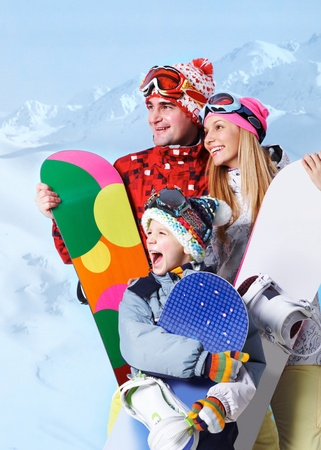 Portrait of happy family with snowboards on winter resort
