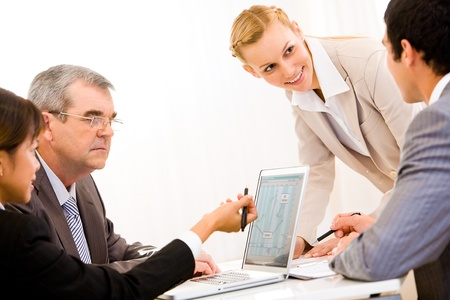 Image of business people communicating at working meeting