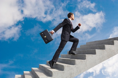 Photo for Image of confident businessman with briefcase walking upstairs - Royalty Free Image