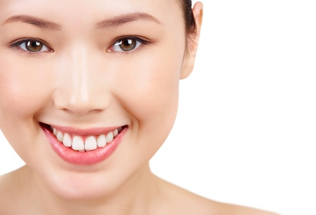 Face of Asian female smiling on white background