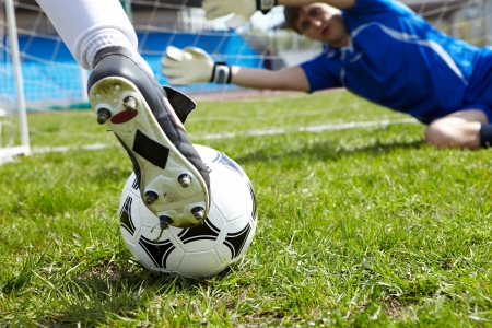 Horizontal image of soccer ball with foot of player kicking it