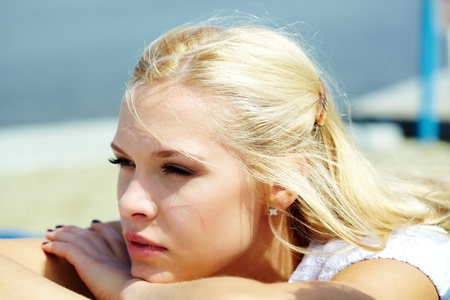 Photo of serene blond woman spending time outdoors