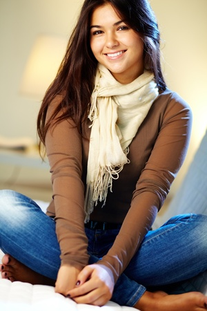 Portrait of young teenage girl looking at camera and smiling
