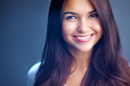 Portrait of young girl with perfect face and teeth