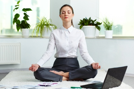 Photo for Portrait of attractive white collar worker meditating in office - Royalty Free Image