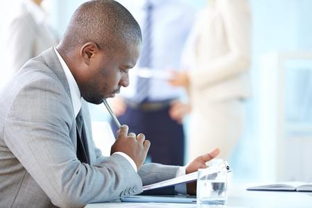 Foto de Pensive entrepreneur thinking over financial results - Imagen libre de derechos