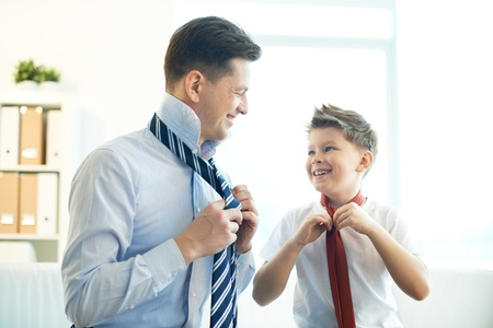 Photo for Photo of happy boy and his father tying neckties - Royalty Free Image