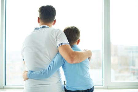 Photo for Rear view of man embracing his son - Royalty Free Image