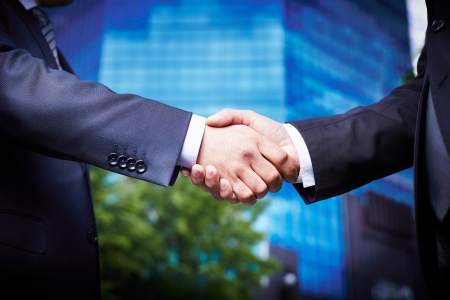 Close-up of business people welcoming each other in the downtown