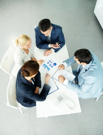 Photo for Above view of successful partners during negotiations at meeting - Royalty Free Image